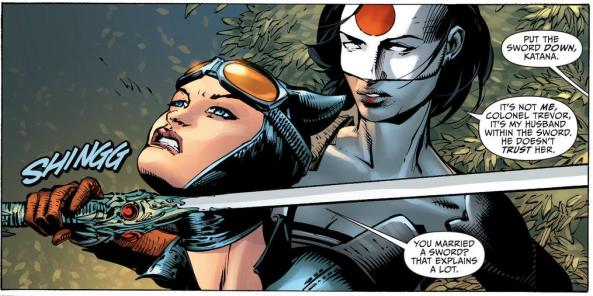 Katana holds her sword to Catwoman's neck