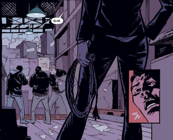 Catwoman confronts her goons